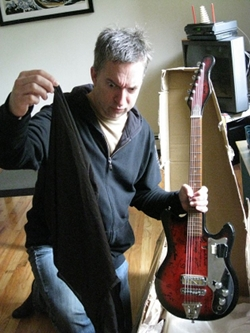 The $100 Guitar, Greg Anderson