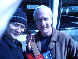 The $100 Guitar, Phil Burk Karl Evangelista
